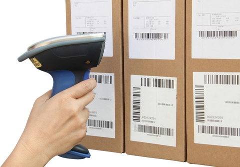 Warehouse shipping labels being scanned